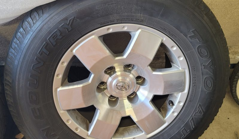 17″ Cruiser Stock Aluminum Alloy Wheels and Toyo Open Country M/T Tires full