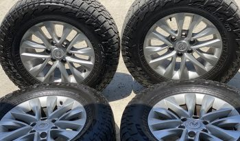 stock GX 18's wildpeaks 275/65 rims are mint. tires has about 5k miles. $750 obo located in Palm Springs CA. full